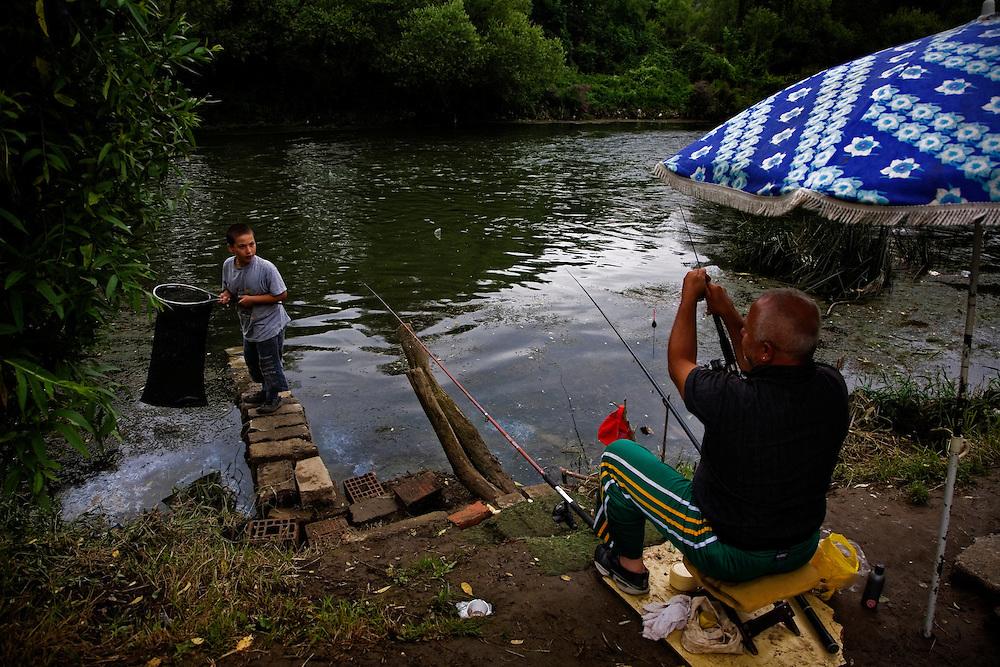 Serbs fishing along the Ibar River in Mitrovica, Kosovo.