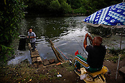 Serbs fishing along the Ibar River in Mitrovica, Kosovo.