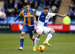 Peter Hartley of Bristol Rovers tackles Louis Dodds of Shrewsbury Town - Mandatory by-line: Robbie Stephenson/JMP - 17/12/2016 - FOOTBALL - Greenhous Meadow - Shrewsbury, England - Shrewsbury Town v Bristol Rovers - Sky Bet League One