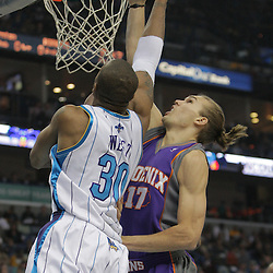 Nov 19, 2009; New Orleans, LA, USA; New Orleans Hornets forward David West (30) shoots over Phoenix Suns forward Louis Amundson (17) during the send quarter at the New Orleans Arena. Mandatory Credit: Derick E. Hingle-US PRESSWIRE