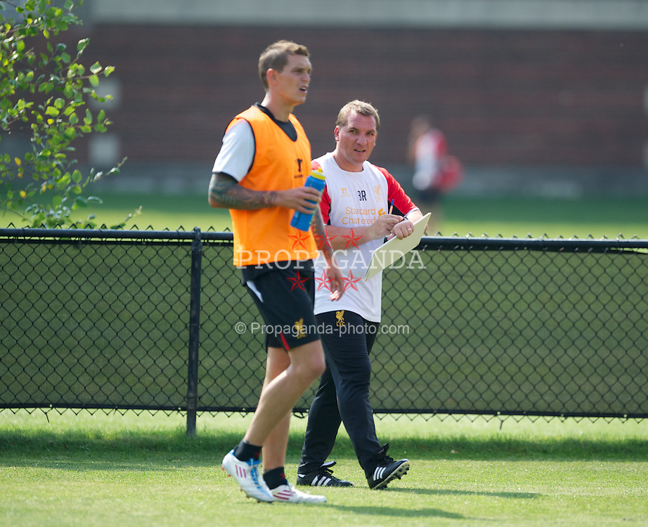 BOSTON, MA - Wednesday, July 18, 2012: Liverpool's manager Brendan Rodgers and Daniel Agger training at the Harvard Stadium fields during the club's North American pre-season tour. (Pic by David Rawcliffe/Propaganda)
