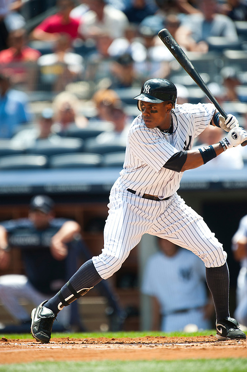 NEW YORK - JULY 27: Curtis Granderson #14 of the New York Yankees bats during the game against the Seattle Mariners at Yankee Stadium on July 27, 2011 in the Bronx borough of Manhattan. (Photo by Rob Tringali) *** Local Caption *** Curtis Granderson