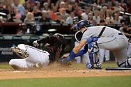 Apr 22, 2017; Phoenix, AZ, USA; Los Angeles Dodgers catcher Austin Barnes (15) tags out the sliding Arizona Diamondbacks starting pitcher Robbie Ray (38) in the second inning at Chase Field. Mandatory Credit: Jennifer Stewart-USA TODAY Sports