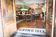 entrance to Grand Isle restaurant in the Warehouse District of New Orleans, Louisiana