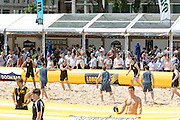 UNITED KINGDOM, London: 31 July 2015 Spectators look on as a game of Beach Rugby gets underway in the heart of London this afternoon at Finsbury Square. The five-a-side rugby tournament imported 240 tonnes of sand for the event, which sees more than 300 rugby players come together and raise money for Help for Heroes. Rick Findler / Story Picture Agency.