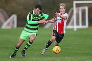 Forest Green Rovers Will Davidson(5) runs forward during the The Central League match between Cheltenham Town Reserves and Forest Green Rovers Reserves at The Energy Check Training Ground, Cheltenham, United Kingdom on 28 November 2017. Photo by Shane Healey.