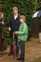 TIMOTHY TAYLOR and his son CASSIUS at the Cartier Style Et Luxe at the Goodwood Festival of Speed, Goodwood House, West Sussex on 24th June 2007.<br />