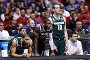 INDIANAPOLIS, IN - MARCH 29: Denzel Valentine #45, Branden Dawson #22 and Matt Costello #10 of the Michigan State Spartans look on against the Duke Blue Devils during the regional round of the 2013 NCAA Men's Basketball Tournament at Lucas Oil Stadium on March 29, 2013 in Indianapolis, Indiana. (Photo by Joe Robbins)