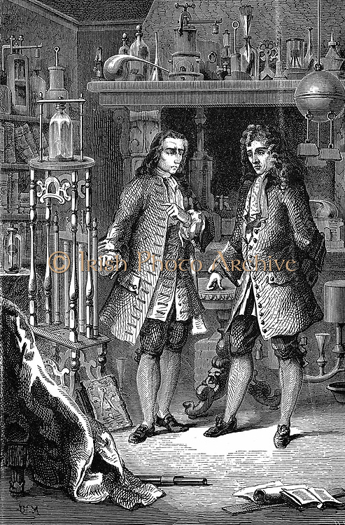 Robert Boyle (1627-1691) Anglo-Irish chemist and physicist, in his laboratory with Denis Papin (1647-1712) French physicist. Papin is pointing to Boyle's air pump. Probably illustrates discussion between Boyle and Papin on use of atmospheric pressure to raise water. Wood engraving Paris 1870.