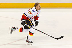 Jan 17, 2012; San Jose, CA, USA; Calgary Flames center Olli Jokinen (13) warms up before the game against the San Jose Sharks at HP Pavilion. San Jose defeated Calgary 2-1 in shootouts. Mandatory Credit: Jason O. Watson-US PRESSWIRE