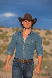 sexy rugged cowboy at sunset