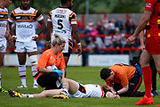 Bradford Bulls scrum half Joe Keyes (7) is attended to after being caught by Dewsbury Rams Lucas Walshaw (4)  during the Kingstone Press Championship match between Dewsbury Rams and Bradford Bulls at the Tetley's Stadium, Dewsbury, United Kingdom on 4 June 2017. Photo by Simon Davies.