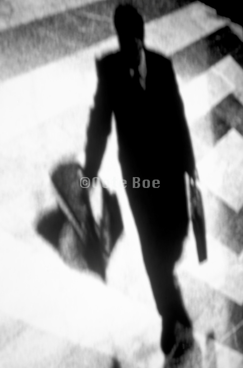 distorted view of business man hurrying across lobby floor