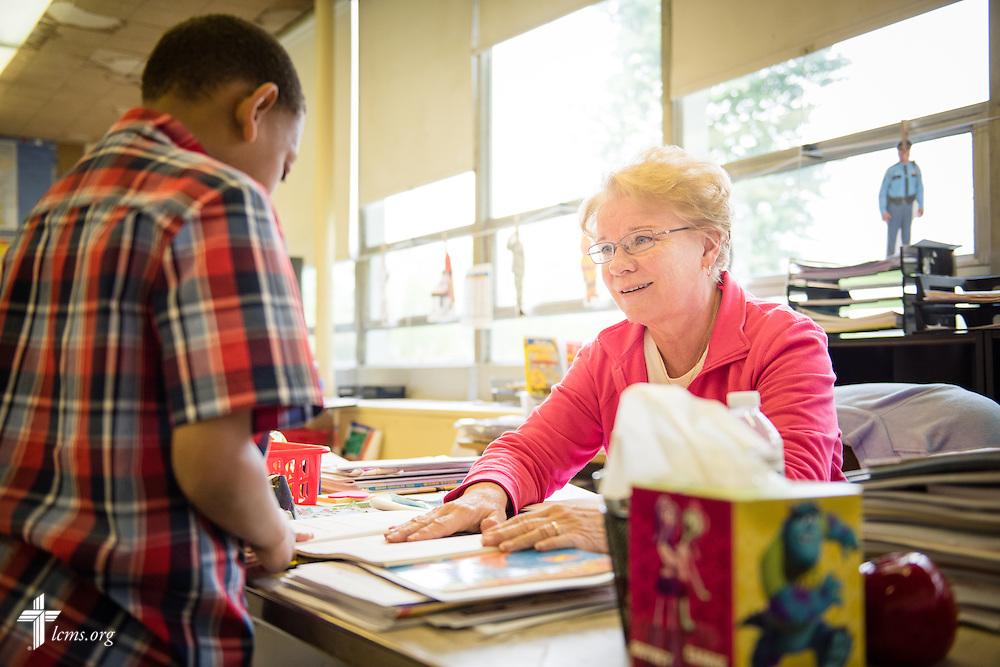 Teacher Nancy Spitzack helps student Tyler Zollicoffer with an activity during class at Lutheran Special School & Education Services, located in Milwaukee Lutheran High School, on Tuesday, May 19, 2015, in Milwaukee, Wis. LCMS Communications/Erik M. Lunsford