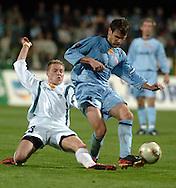n/z.: Bartosz Slusarski (nr23-Groclin) , Arkadiusz Baran (nr8-Groclin) podczas meczu ligowego Groclin Grodzisk Wlkp. (biale) - Cracovia Krakow (niebieskie) 3:1 , I liga polska , 20 kolejka sezon 2004/2005 , pilka nozna , Polska , Grodzisk Wielkopolski , 02-05-2005 , fot.: Adam Nurkiewicz / mediasport..Bartosz Slusarski (nr23-Groclin) , Arkadiusz Baran (nr8-Groclin) fight for the ball during Polish league first division soccer match in Grodzisk Wielkopolski. May 02, 2005 ; Groclin Grodzisk Wlkp. (white) - Cracovia Cracow (blue) 3:1 ; first division , 20 round season 2004/2005 , football , Poland , Grodzisk Wielkopolski ( Photo by Adam Nurkiewicz / mediasport )