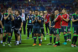 LYON, FRANCE - Wednesday, July 6, 2016: Wales' Neil Taylor applauds the supporters following the 2-0 defeat to Portugal during the UEFA Euro 2016 Championship Semi-Final match at the Stade de Lyon. (Pic by David Rawcliffe/Propaganda)