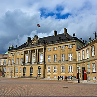 Amalienborg Palaces History in Copenhagen, Denmark <br /> In 1448, Count Christian I became the King of Denmark. To celebrate the 300th anniversary of Danish rule by the House of Oldenburg, King Frederick V commissioned the design of four identical mansions for noble families. The project in the Frederiksstaden District, which is now collectively called Amalienborg, was acquired by the king and queen in 1794 when their Christiansborg Palace was destroyed by fire. The palaces still serve as the winter residence for the Royal Family.