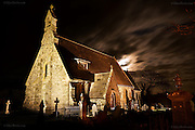 Within 2 minutes I was in Llanfaelog and the most spectacular view presented itself, a full moon right behind an amazing flood-lit church of St Faelog. Even though I was in a blinding hurry, I decided to stop the van and shoot the scene anyway. Actually the moon and church weren't in the ideal alignment for the composition I wanted but by bracing my tripod over the steps of the church, I could just create a composition that worked. I shot about four exposures at varying shutter speeds to get the right cloud coverage of the moon (so much more interesting than the moon alone) and as I was making the last exposure, a huge silent white Barn Owl glid across the scene in front of me, straight out of a Tim Burton film :-) Of course with 20 second exposures there was no chance of me recording this beautiful creature, but it will always be there in memory and will always remain magical. There were other movements in the graveyard, rustles, snaps and slithers but I couldn't actually see anything. At one point I felt something brush against my trousers but still saw nothing.