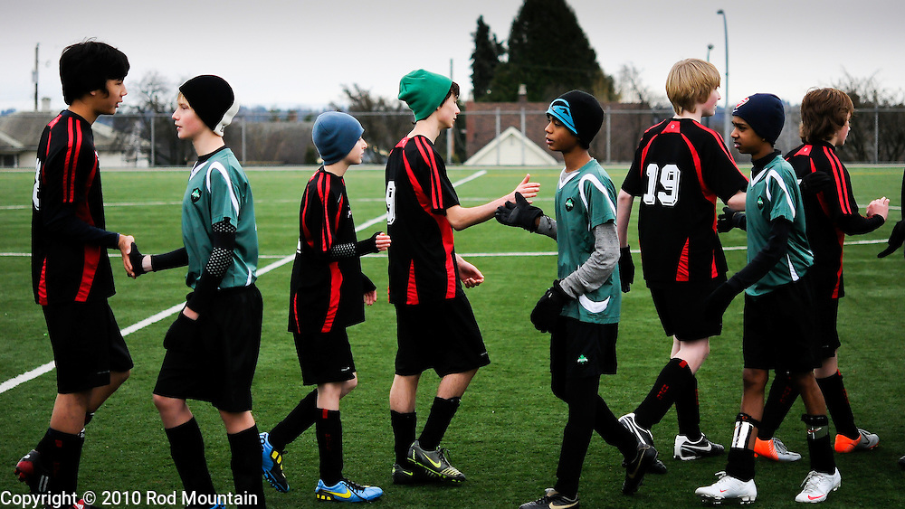 A group of boys lineup after the Soccer match to shake hands with the other team. Burnaby, British Columbia.<br />