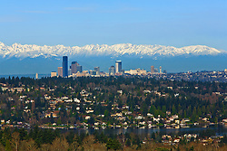 North America, United States, Washington. Lake Washington, Mercer Island, Seattle skyline, and Olympic mountains viewed from Bellevue.