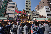 Mikoshi are carried around the streets of Asakusa during the Sanja matsuri. Asakusa, Tokyo, Japan. Sunday May 15th 2016 The Sanja matsuri is one of the biggest festivals in Japan. Taking place over the 3 days of the second weekend of May (May 13th to 15th) it features many mikoshi, or portable shrines, that are carried around by local groups to bring blessings and prosperity to their neighbourhoods