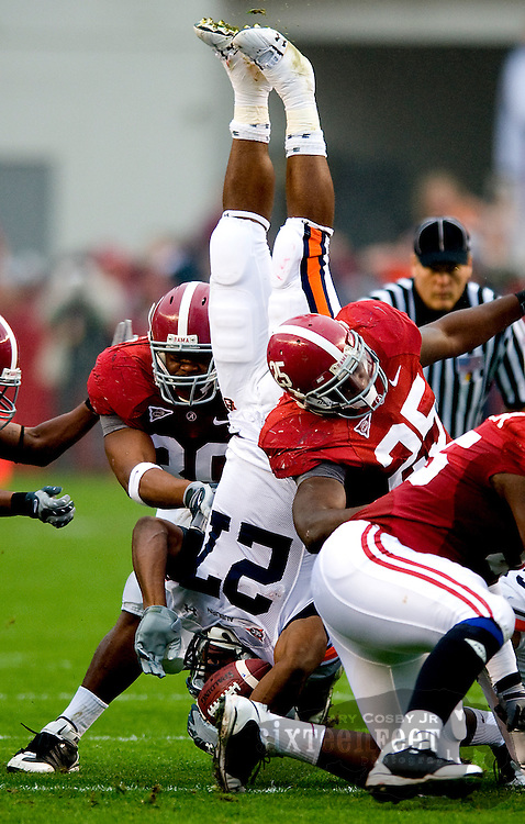 Alabama linebackers Dont'a Hightower and Rolando McClain upend Auburn running back Mario Fannin during the Iron Bowl in Tuscaloosa's Bryant Denny Stadium in 2008 ending a run of six straight Auburn victories.  Photo by Gary Cosby Jr.   11/29/08