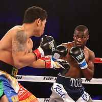 Toka Kahn Clary fights John Gemino during the Top Rank boxing event at Osceola Heritage Park in Kissimmee, Florida on September 22, 2016.