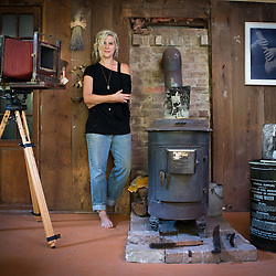 September 20, 2014 - Paw Paw, West Virginia - Photographic artist Lisa Elmaleh poses with her equipment, truck, and outside her cabin in Paw Paw, West Virginia.  Photograph by Susana Raab