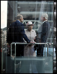 HM The Queen and the The Duke of Edinburgh in a lift as they visit  the Lloyds of London building in the City of London, with The Chairman of Lloyds of London John Nelson, Thursday, 27th March 2014. Picture by Andrew Parsons / i-Images