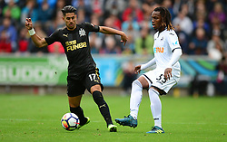 Renato Sanches of Swansea City passes under pressure from Ayoze Perez of Newcastle United - Mandatory by-line: Alex James/JMP - 10/09/2017 - FOOTBALL - Liberty Stadium - Swansea, England - Swansea City v Newcastle United - Premier League