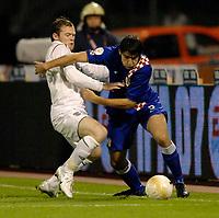 "Photo: Richard Lane.<br />Croatia v England. UEFA European Championships 2008 Qualifying. 11/10/2006. <br />England""s Wayne Rooney challenges Croatia's Vedran Corluka."