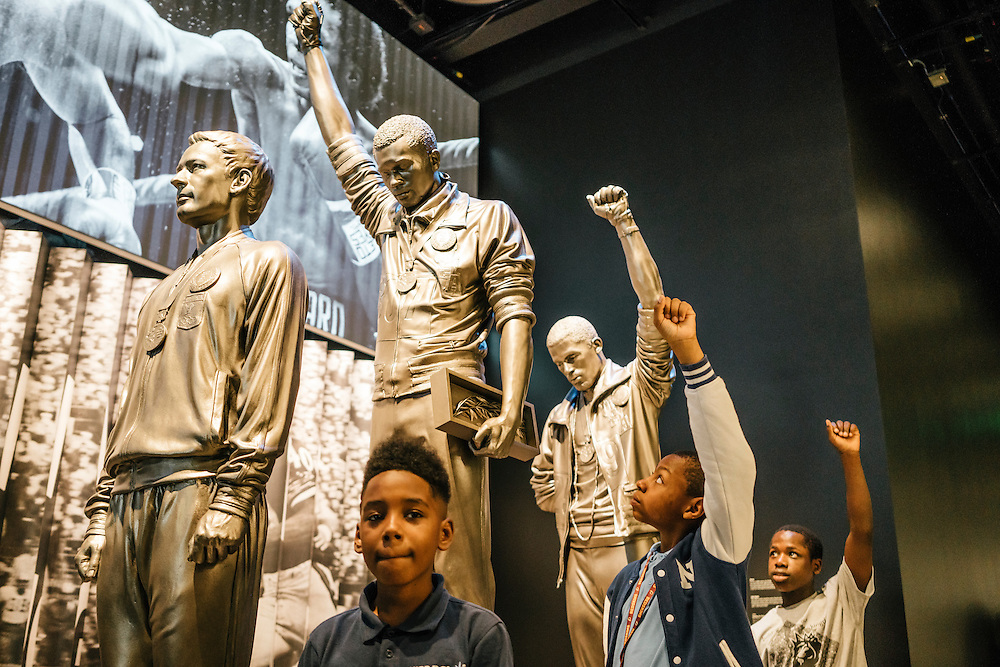 Sixth-graders from Knowledge Is Power Program (KIPP) DC, including Tyron Proctor, 11, Omari Sterling, 11, and Tay'sean Barrow, 12, pose next to an iconic statue of Jesse Owens inside the Smithsonian National Musuem of African American History and Culture during their visit on Oct 21, 2016. The students spent an hour touring the new Washington, D.C. museum, which is only available to see with reserved tickets during the first year.