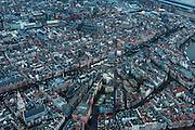 Nederland, Noord-Holland, Amsterdam, 16-01-2014;<br /> Historische centrum van Amsterdam rond de Nieuwmarkt (m) met de Waag, de Oude kerk iets hoger in beeld, met daartussen de rosse buurt (Wallen). Diagonaal door beeld loopt het water van de Kloveniersburgwal (links) en de Geldersekade (na de Nieuwmarkt rechts). Zuiderkerk links beneden. Rechtsboven het Centraal station.<br /> Historic center of Amsterdam around the Nieuwmarkt (m) with the Waag (Weigh house), the Old Church (m,t), separated by the red light district.<br /> luchtfoto (toeslag op standard tarieven);<br /> aerial photo (additional fee required);<br /> copyright foto/photo Siebe Swart