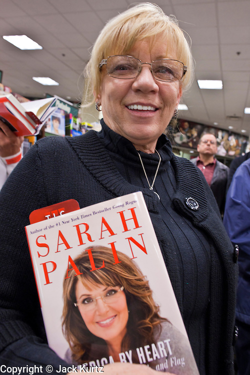 "23 NOVEMBER 2010 - PHOENIX, AZ:  MARY WHITE from Scottsdale, AZ, stands in line with her copies of Sarah Palin's new book, ""America by Heart"" in Phoenix Tuesday. Palin signed copies of her new book, ""America by Heart"" at the store in north Phoenix Tuesday night, Nov. 23. It was the kick off of her book tour to support America by Heart. Palin is frequently mentioned as a possible Republican candidate for US President in 2012.   Photo by Jack Kurtz"