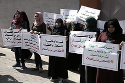 April 5, 2017 - Gaza, gaza strip, Palestine - Protesters hold banners during a protest demanding punish of people who spy for Israel in front of the Ansar jail in Gaza City, Gaza on April 5, 2017. (Credit Image: © Majdi Fathi/NurPhoto via ZUMA Press)