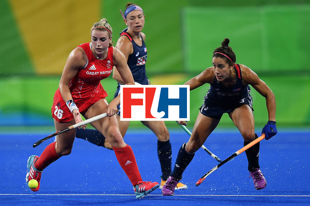 Britain's Lily Owsley (L) and USA's Melissa Gonzalez vie during the women's field hockey Britain vs the USA match of the Rio 2016 Olympics Games at the Olympic Hockey Centre in Rio de Janeiro on August, 13 2016. / AFP / MANAN VATSYAYANA        (Photo credit should read MANAN VATSYAYANA/AFP/Getty Images)
