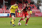Oxford midfielder Callum O'Dowda takes  on Crawley Town Defender Joe McNerney during the Sky Bet League 2 match between Crawley Town and Oxford United at the Checkatrade.com Stadium, Crawley, England on 9 April 2016. Photo by David Charbit.