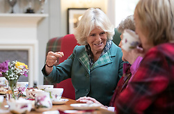 The Duchess of Cornwall, known as the Duchess of Rothesay in Scotland, has morning tea with members of the local community during her visit to the Duke of Rothesay Highland Games Pavilion in Braemar, Aberdeenshire.