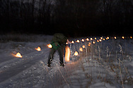Jorge Sanchez of Centerville helps light the candles before the Holiday stroll and luminaria walk from Forest Field Park, through the meadows of Bill Yeck Park to the historic Smith home, part of the Centerville-Washington Township Park District, Friday, December 17, 2010.