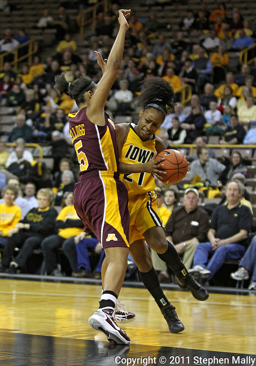February 10 2011: Iowa Hawkeyes guard Kachine Alexander (21) tries to get around Minnesota Golden Gophers forward Kionna Kellogg (5) during the first half of an NCAA women's college basketball game at Carver-Hawkeye Arena in Iowa City, Iowa on February 10, 2011. Iowa defeated Minnesota 64-62.