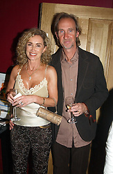 MIKE & ANGIE RUTHERFORD at a party to celebrate the publication of Paul McKenna's new book 'I Can Make You Thin' held at the Soho Hotel, 4 Richmond Mews, London W1 on 8th March 2005.<br />