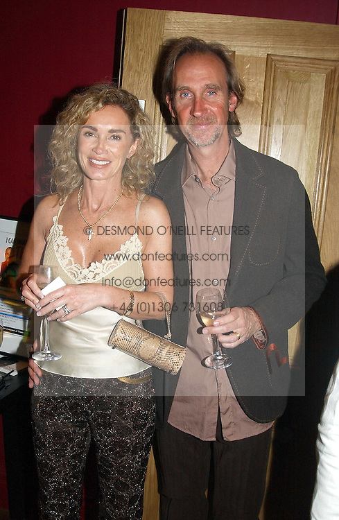 MIKE &amp; ANGIE RUTHERFORD at a party to celebrate the publication of Paul McKenna's new book 'I Can Make You Thin' held at the Soho Hotel, 4 Richmond Mews, London W1 on 8th March 2005.<br />