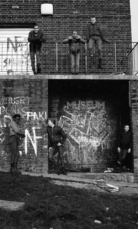 Gang of Skins on Balcony with racist graffiti, London, 1980's.