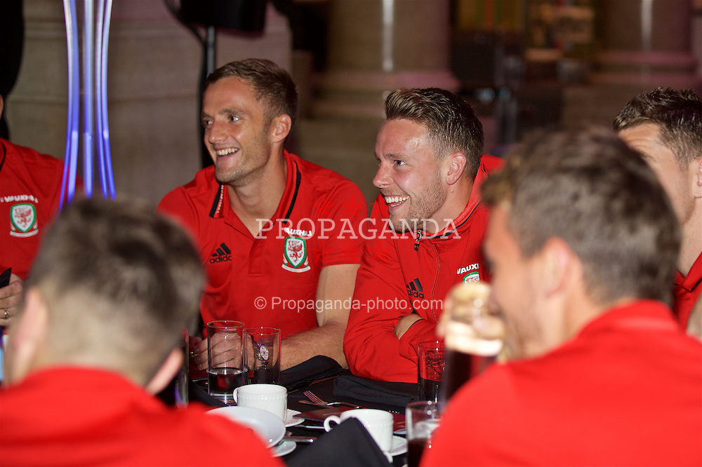 CARDIFF, WALES - Wednesday, August 31, 2016: Wales' Andy King and Chris Gunter during a gala dinner at the Cardiff Museum to launch the UEFA Champions League Finals 2017 to be held in Cardiff. (Pic by David Rawcliffe/Propaganda)