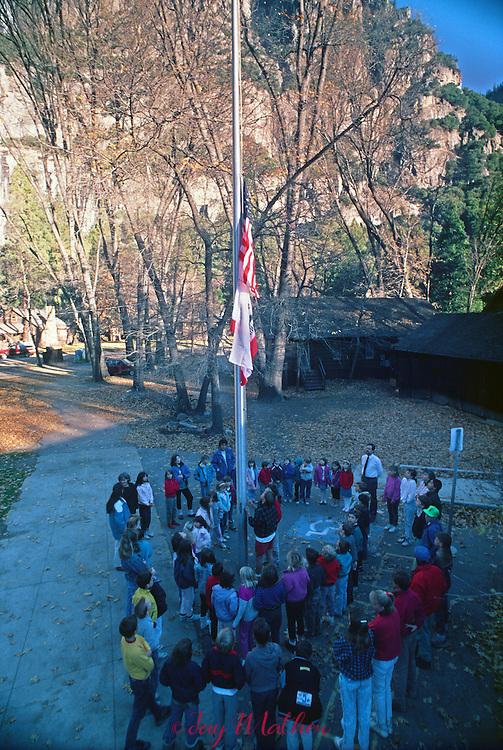 Photographs from the project documenting the 100th anniversary of Yosemite National Park in 1990.<br /> <br /> Yosemite Elementary school and staff raise the flag each morning before classes begin.