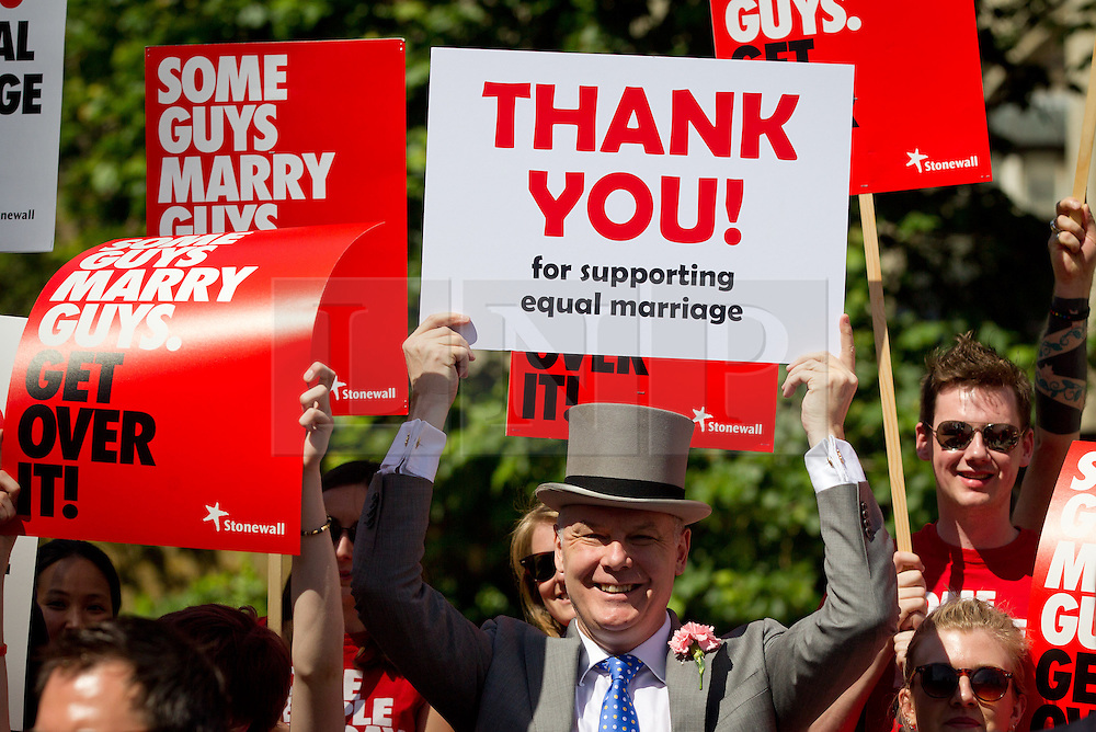 © Licensed to London News Pictures. 15/07/2013. London, UK. Supporters of lesbian, gay and bisexual charity Stonewall are seen campaigning outside Parliament in London today (15/07/2013) as MP's hear the final reading of a proposed bill to allow same sex marriages to become law. Photo credit: Matt Cetti-Roberts/LNP