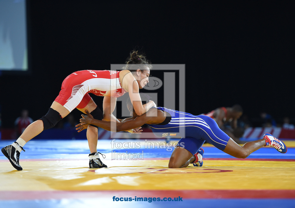 Brittanee Laverdure Canada (red) and Joseph Essombe Tiako Camaroon (blue) in the 55kg class on day three of the wrestling at The SECC Precinct, Glasgow<br /> Picture by Alan Stanford/Focus Images Ltd +44 7915 056117<br /> 31/07/2014