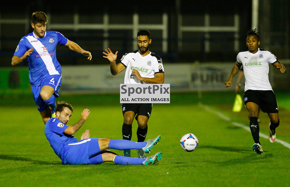 Eastleigh's midfielder Josh Payne (8) slides the ballaway from Dover's striker Stefan Payne (23) while Eastleigh's defender Will Evans (4) and Dover's defender Aswad Thomas (21) can only look on. Dover Athletic v Eastleigh. Vanarama National League. 10  November 2015. (c) Matt Bristow | SportPix.org.uk