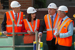 © Licensed to London News Pictures. 05/09/2013. London, UK. Shadow Chancellor Ed Balls (2R), Shadow Chief Secretary to the Treasury Rachel Reeves (2L) and Sir John Armitt chief of a review of long-term infrastructure planning in the UK (L) receive a progress briefing at the site of the Bond Street Crossrail station in London today (05/09/2013) from Terry Morgan, the chairman of Crossrail. The station forms part of the Crossrail train line, which will be 73 miles (118 km) long when finished in 2018, will connect Maidenhead and Heathrow in the west of London to Shenfield and Abbey Wood in the east, passing under central London to create a new commuter link. Photo credit: Matt Cetti-Roberts/LNP