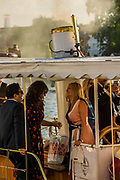 People arrive by boat or float by to listen to the music from teh river - Henley Festival is a boutique event over five days celebrating the best of UK & international music and arts with a programme from pop to world music, classical to jazz, blues to jazz musicians, where art, comedy and gastronomy share equal billing with music. Henley on Thames 05 July 2017